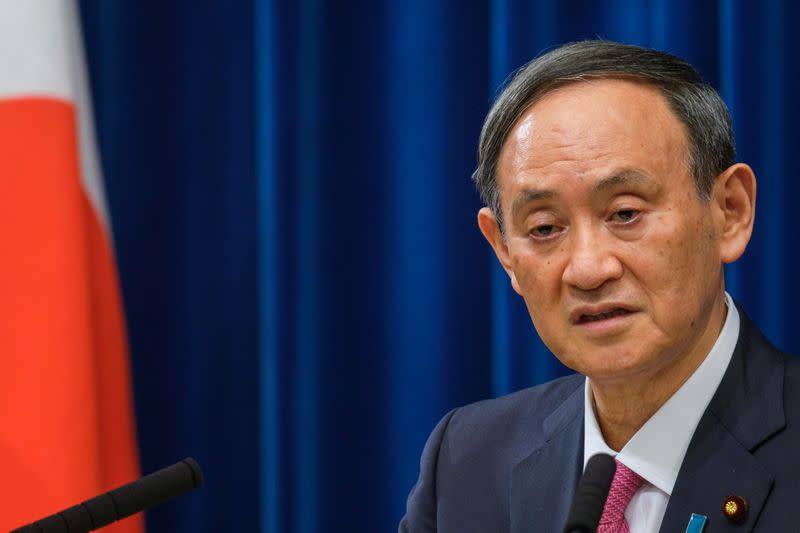 Japan's Prime Minister Suga Yoshihide holds a news conference in Tokyo
