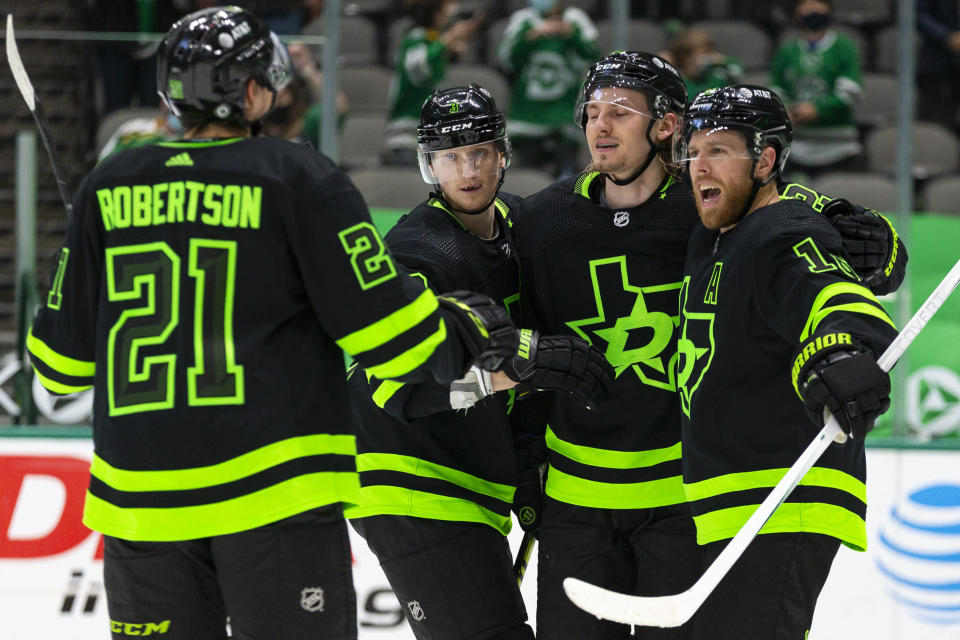Dallas Stars center Joe Pavelski, right, celebrates with teammates after scoring a goal during the second period of an NHL hockey game against the Columbus Blue Jackets Saturday, April 17, 2021, in Dallas. (AP Photo/Sam Hodde)
