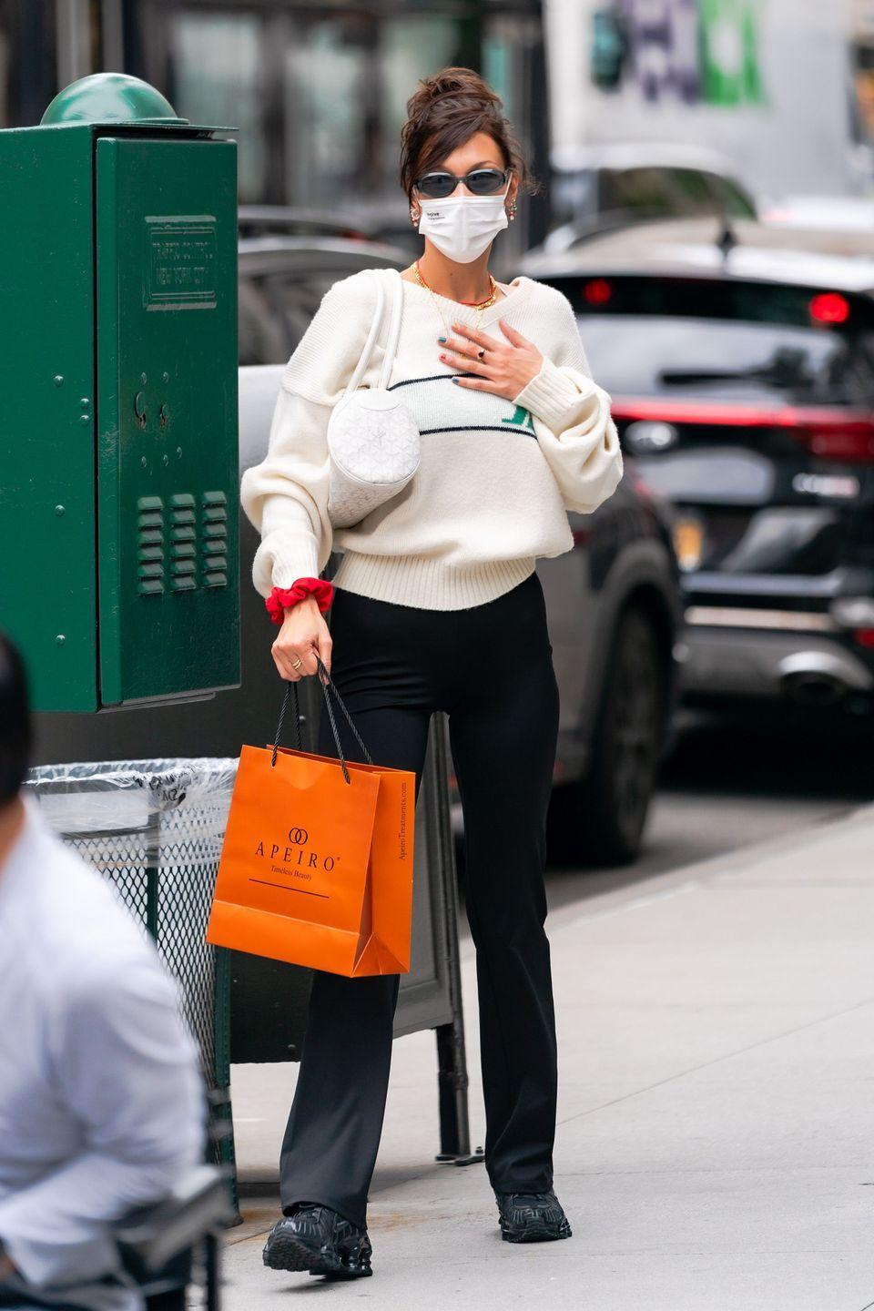 <p>The new auntie was seen out for lunch with friends in New York City days after her older sister Gigi welcomed her first child. </p><p>The model wore black trousers and a cream-coloured V-neck jumper for the occasion teamed with a white face mask. </p>