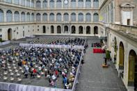 People sat on socially-distanced chairs to listen to his audience in the San Damaso Courtyard at the Vatican.