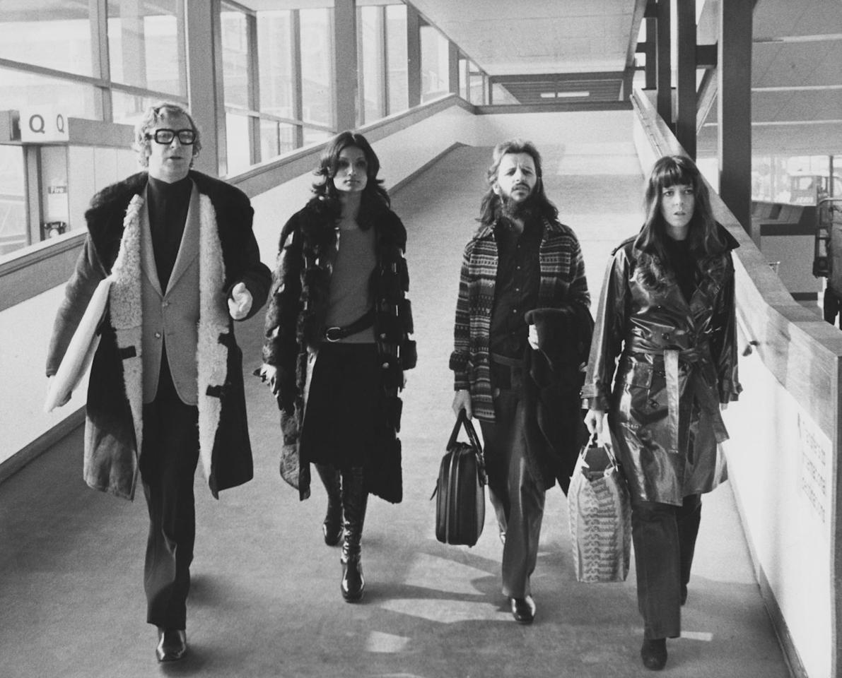 <p>Michael Caine, his future wife Shakira Baksh, Ringo Starr, and his wife Maureen at London's Heathrow Airport in 1972. The four are departing for Budapest, where they will be guests at 40th birthday celebrations for actress Elizabeth Taylor.</p>