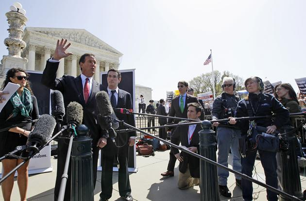 Republican presidential candidate Rick Santorum speaks in front of the Supreme Court.