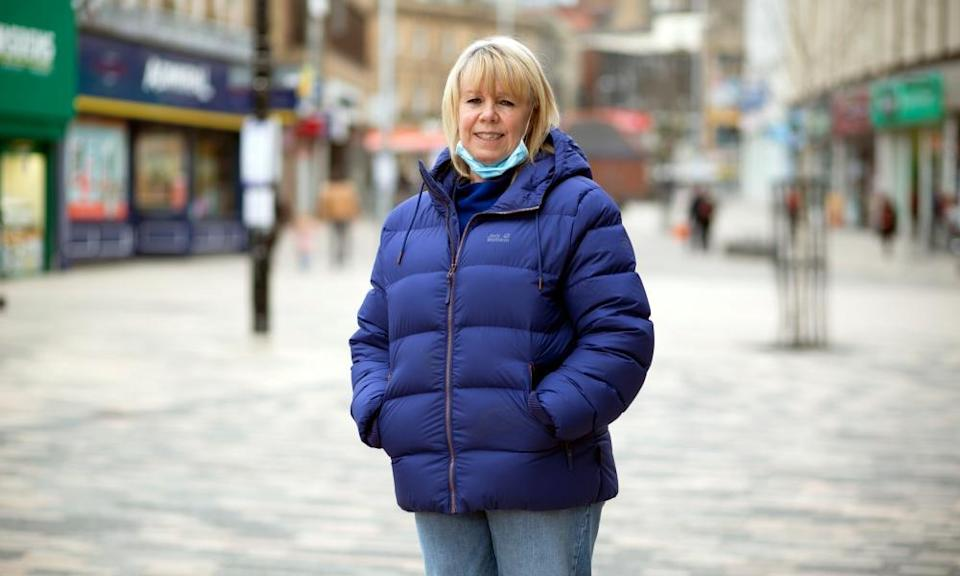 Karen Grant standing in the pedestrianised shopping area with her hands in the pockets of her blue winter coat