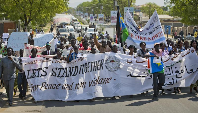"South Sudanese people take part in a peace march organised by civil society groups in the capital Juba, South Sudan Wednesday, Jan. 8, 2014. Officials in Ethiopia say peace talks for South Sudan are stalled over the issue of political prisoners, describing the talks as ""on and off"" after the special envoy of a bloc of East African countries known as IGAD flew to South Sudan to speak about political detainees. (AP Photo/Ali Ngethi)"