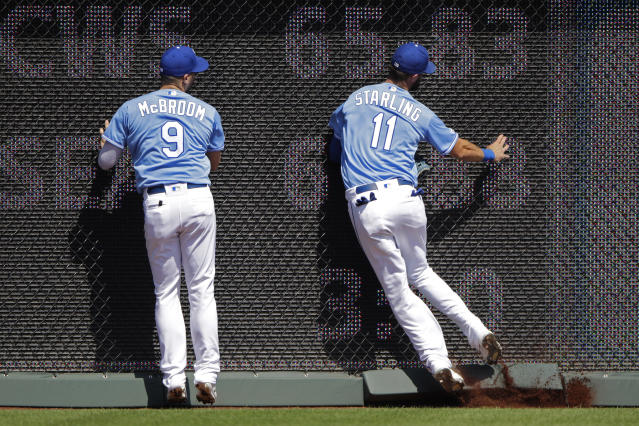 Kansas City Royals left fielder Ryan McBroom (9) and center fielder Bubba Starling (11) hit the wall after Starling caught a fly ball for an out against Houston Astros' Alex Bregman during the second inning of a baseball game Sunday, Sept. 15, 2019, in Kansas City, Mo. (AP Photo/Charlie Riedel)