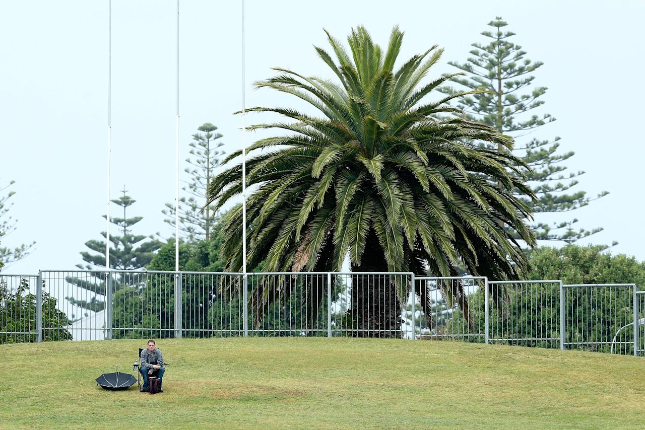 NAPIER, NEW ZEALAND - DECEMBER 29:  A spectator looks on as rain delays game two of the One Day International series between New Zealand and the West Indies at McLean Park on December 29, 2013 in Napier, New Zealand.  (Photo by Hagen Hopkins/Getty Images)