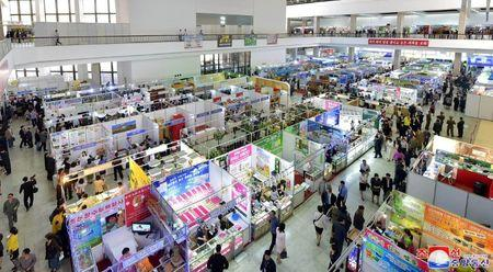 FILE PHOTO: Vendors and visitors at the 21st Pyongyang Spring International Trade Fair at the Three-Revolution Exhibition House, in this undated photo released by North Korea's Korean Central News Agency (KCNA) in Pyongyang May 22, 2018. KCNA/via REUTERS