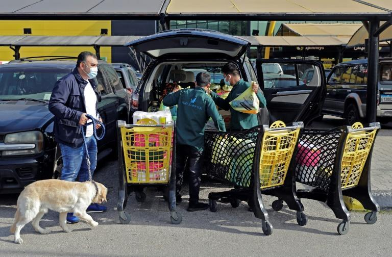Lebanese have been scrambling to stock up on essential supplies for days in readiness for the strict new lockdown under which supermarkets will offer delivery services only