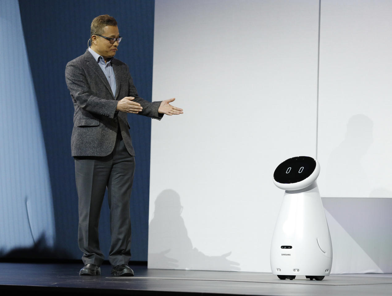 Gary Lee, senior vice president and head of the AI Center at Samsung Electronics, unveils the Bot Care robot during a Samsung news conference at CES International, Monday, Jan. 7, 2019, in Las Vegas. (AP Photo/John Locher)