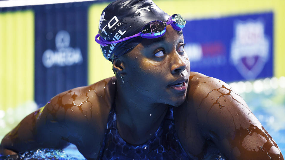 Simone Manuel looks at her time after competing in the US Olympic Trials.