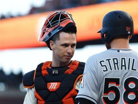 Jun 19, 2018; San Francisco, CA, USA; San Francisco Giants catcher Buster Posey (28) speaks with Miami Marlins starting pitcher Dan Straily (58) between plays during the second inning at AT&T Park. Mandatory Credit: Kelley L Cox-USA TODAY Sports