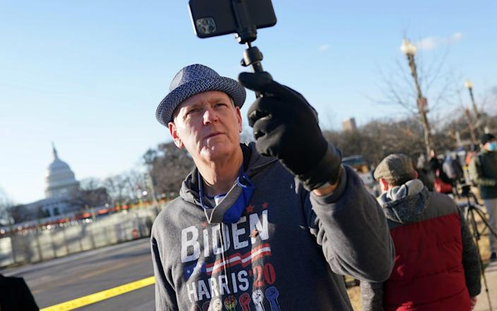 A supporter of U.S. President-elect takes a selfie in front of the U.S. Capitol - Nathan Howard/Getty Images North America