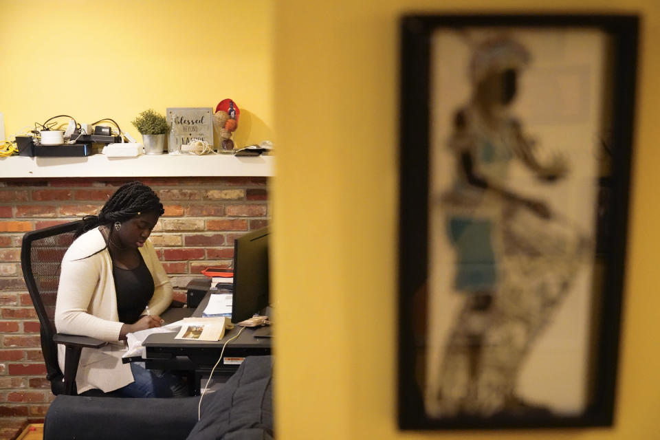 Ebele Azikiwe, 12, writes at her desk at home in Cherry Hill, N.J., Wednesday, March 24, 2021. Azikiwe testified in October at a state Assembly hearing, lending her support to legislation requiring New Jersey's school districts to add diversity to curriculums. Democratic Gov. Phil Murphy signed the bill into law. (AP Photo/Matt Rourke)