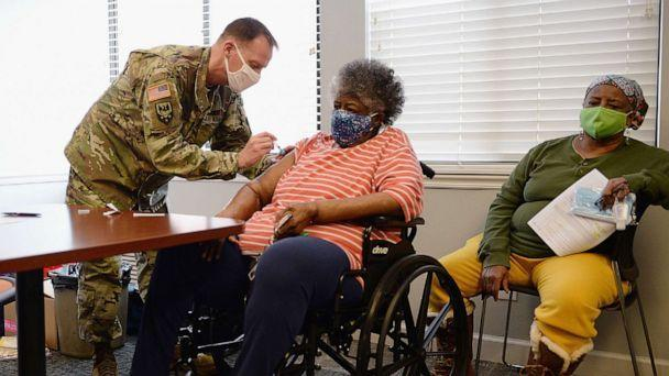 PHOTO: Staff Sergeant Herbert Lins of the Missouri Army National Guard administers the COVID-19 vaccine to a resident during a vaccination event on Feb. 11, 2021 at the Jeff Vander Lou Senior living facility in St Louis, Mo. (Michael Thomas/Getty Images, File)