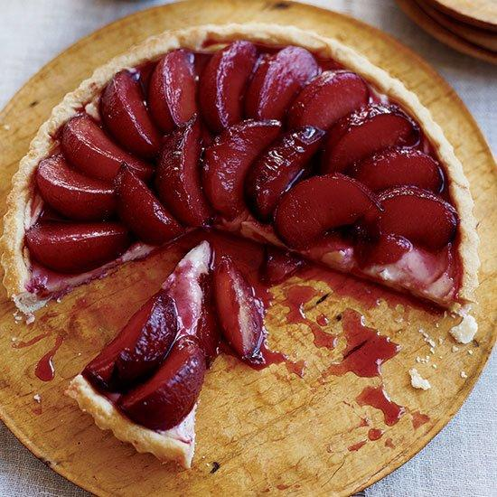 """<p>Nina Planck believes in eating """"real"""" food in its purest, least-processed state, including unpasteurized whole milk with a thick layer of cream on top. She makes this elegant, juicy custard tart with fresh butter, eggs, milk and--when they're available locally--sweet, firm Green Gage plums.</p><p><a href=""""https://www.foodandwine.com/recipes/poached-plum-tart"""">GO TO RECIPE</a></p>"""