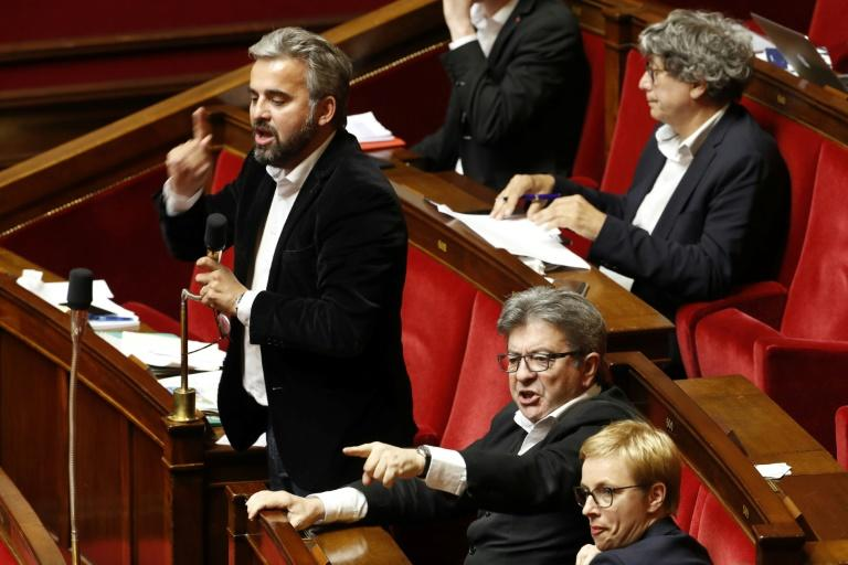 French leftist La France Insoumise members of Parliament Alexis Corbiere (L) and Jean-Luc Melenchon (R) gestures while speaking during a debate prior to the vote on the state owned railway SNCF reform June 13, 2018