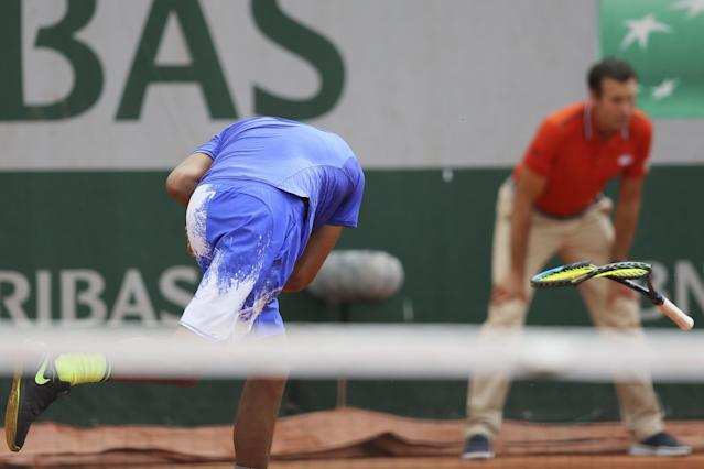 Nick Kyrgios smashed his racquet in frustration on Thursday at the French Open. (AP Images)