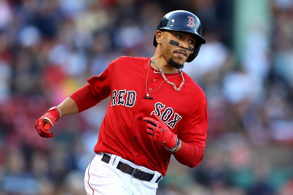 BOSTON, MASSACHUSETTS - SEPTEMBER 29: Mookie Betts #50 of the Boston Red Sox runs to first base during the fifth inning against the Baltimore Orioles at Fenway Park on September 29, 2019 in Boston, Massachusetts. (Photo by Maddie Meyer/Getty Images)