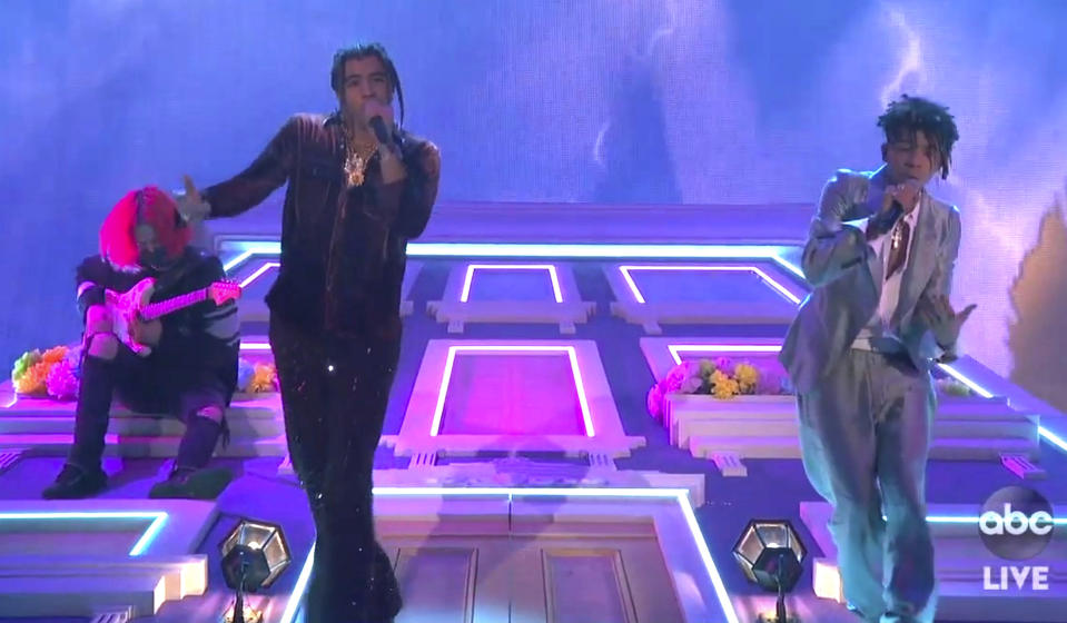 "In this screen shot provided by ABC on Sunday, Nov. 22, 2020, 24KGOLDN, left, and Iann Dior perform ""Mood""at the American Music Awards at the Microsoft Theater in Los Angeles. (ABC via AP)"