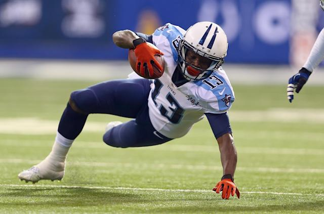 INDIANAPOLIS, IN - DECEMBER 01: Kendall Wright #13 of the Tennessee Titans runs with the ball during the NFL game against the Indianapolis Colts at Lucas Oil Stadium on December 1, 2013 in Indianapolis, Indiana. (Photo by Andy Lyons/Getty Images)