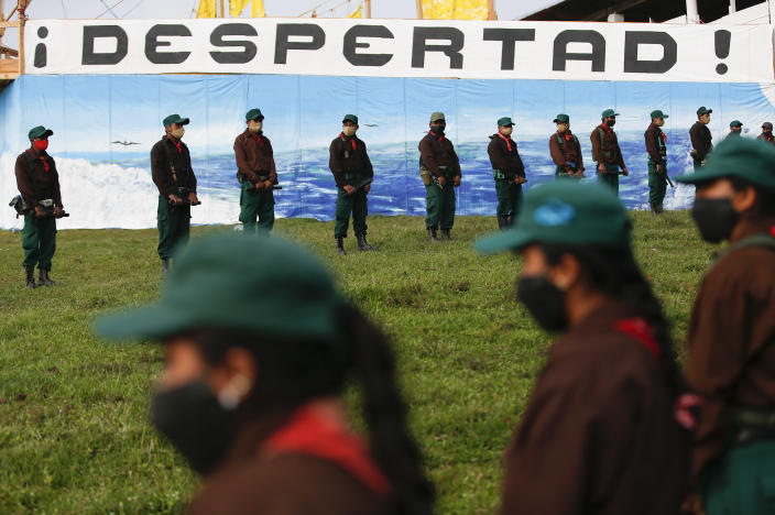 Members of the Zapatista Army of National Liberation, EZLN, wait to bid farewell to a delegation that will leave for Europe on May 3, in the community of Morelia, Chiapas state, Mexico, Monday, April 26, 2021. The rebels say they are planning to take canoes on a trip to 'invade' Spain in May and June, as Mexico marks the anniversary of the 1519-1521 Spanish Conquest of Mexico. (AP Photo/Eduardo Verdugo)
