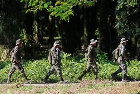 Soldiers patrol during a temporary state of siege, approved by the Guatemalan Congress following the death of several soldiers last week, in the community of Semuy II, Izabal province