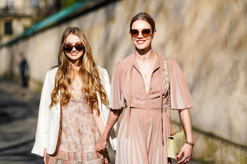 Natalia is seen outside Dior with her half sister Kristina Kusakina during Paris Fashion Week. [Image: Getty]