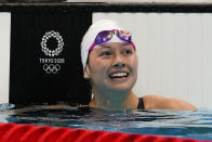 Siobhan Bernadette Haughey, of Hong Kong, reacts after winning the women's 100-meter freestyle semifinal at the 2020 Summer Olympics, Thursday, July 29, 2021, in Tokyo, Japan. (AP Photo/Martin Meissner)