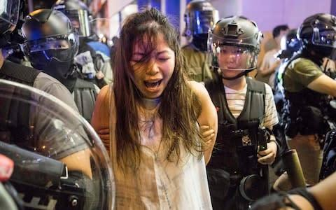 <span>A protester is arrested in Hong Kong on Monday</span>