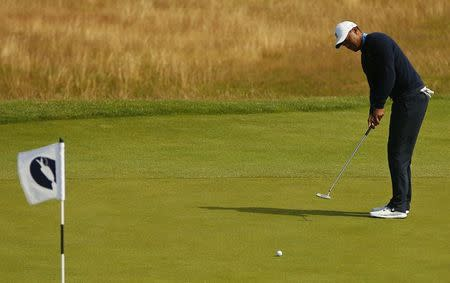 Tiger Woods of the U.S. putts on the 12th green during a practice round ahead of the British Open Championship at the Royal Liverpool Golf Club in Hoylake, northern England July 13, 2014. REUTERS/Phil Noble
