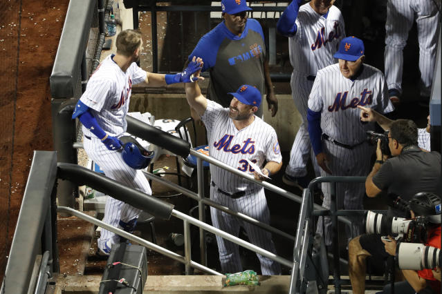 New York Mets manager Mickey Callaway (36) greets Jeff McNeil, left, at the dugout steps after McNeil hit a two-run home run during the sixth inning of a baseball game against the Arizona Diamondbacks, Wednesday, Sept. 11, 2019, in New York. (AP Photo/Kathy Willens)