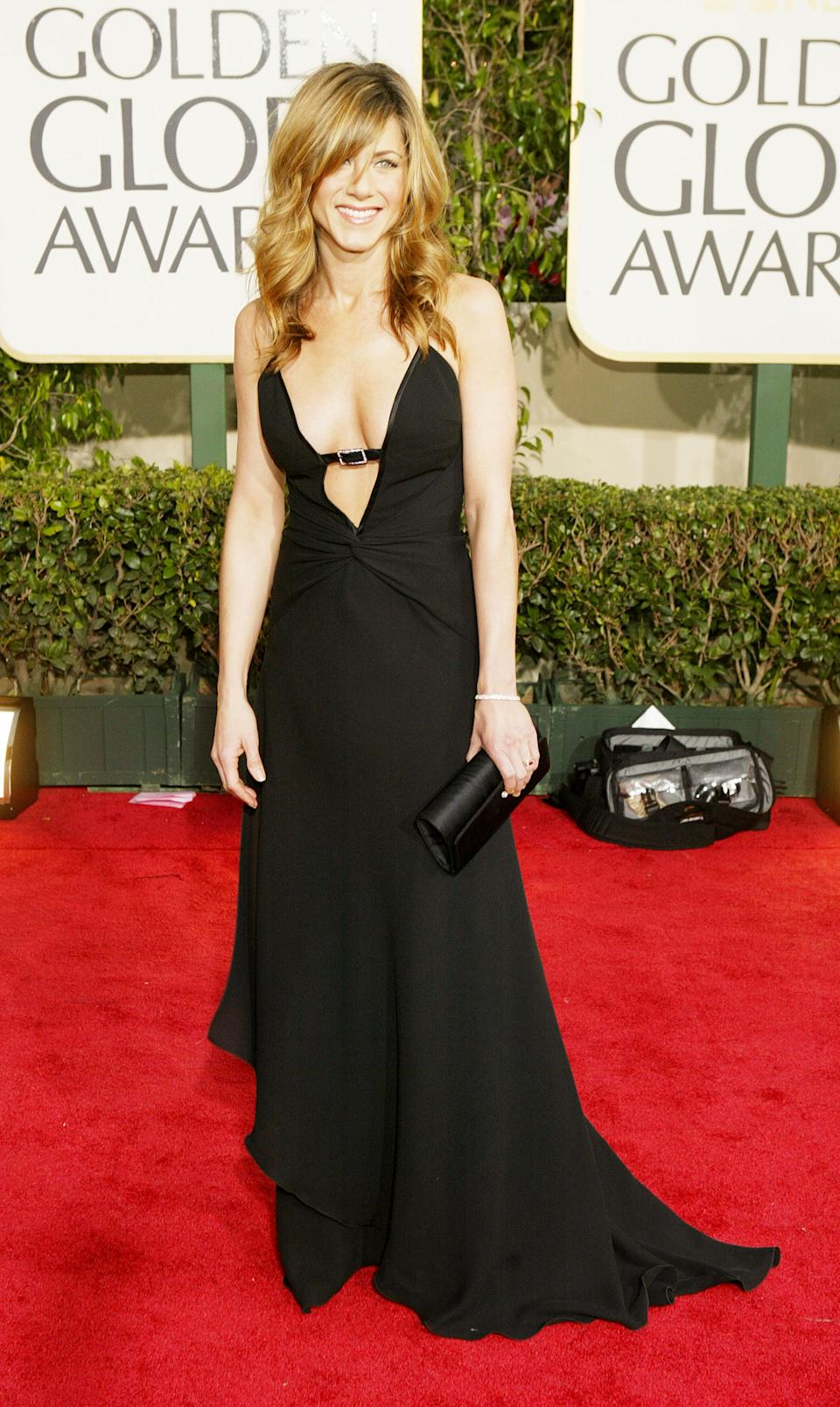 A strategically placed buckle added an edge to Aniston's black gown at the 2004 Golden Globe Awards (Photo by Carlo Allegri/Getty Images)