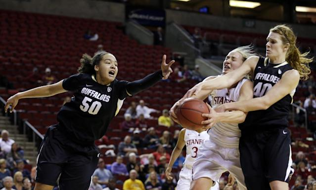 Colorado's Jamee Swan (50) reaches out as Stanford's Mikaela Ruef, second from right, and Colorado's Jamee Swan, right, battle for the ball in the first half of an NCAA college basketball game in the second round of the Pac-12 women's tournament on Friday, March 7, 2014, in Seattle. (AP Photo/Ted S. Warren)