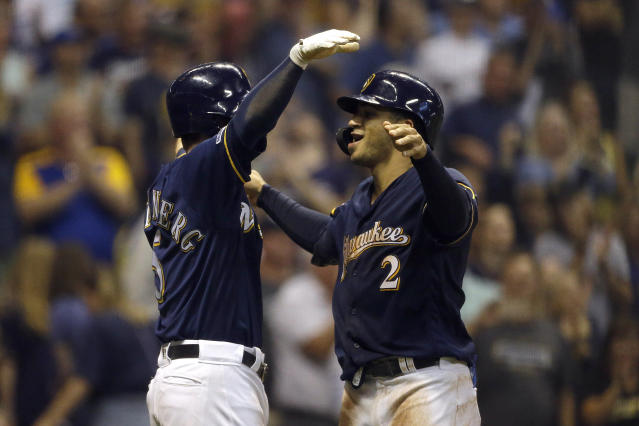 Milwaukee Brewers' Trent Grisham (2) is congratulated by teammate Cory Spangenberg hitting a two-run home run during the seventh inning of a baseball game against the Pittsburgh Pirates, Saturday, Sept. 21, 2019, in Milwaukee. (AP Photo/Aaron Gash)
