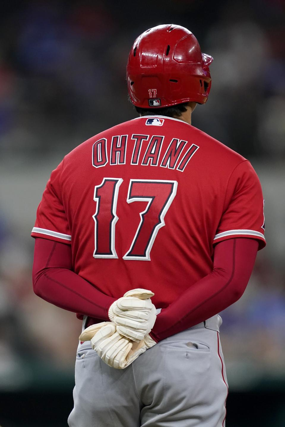 Los Angeles Angels' Shohei Ohtani stands on first after hitting for a single in the sixth inning of a baseball game against the Texas Rangers in Arlington, Texas, Wednesday, Sept. 29, 2021. (AP Photo/Tony Gutierrez)