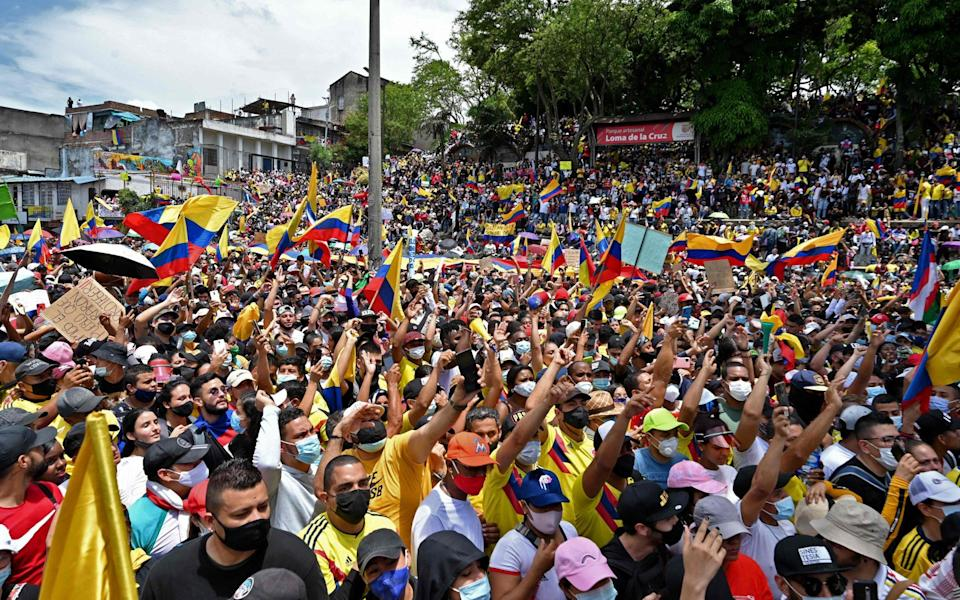 People protest against a tax reform bill they say will leave them poorer as the country battles its deadliest phase yet of the coronavirus pandemic, in Cali, Colombia - LUIS ROBAYO/AFP