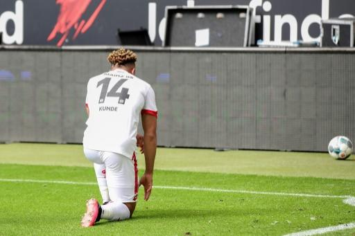 Mainz's Pierre Kunde Malong takes a knee in solidarity with protests raging across the United States over the death of George Floyd