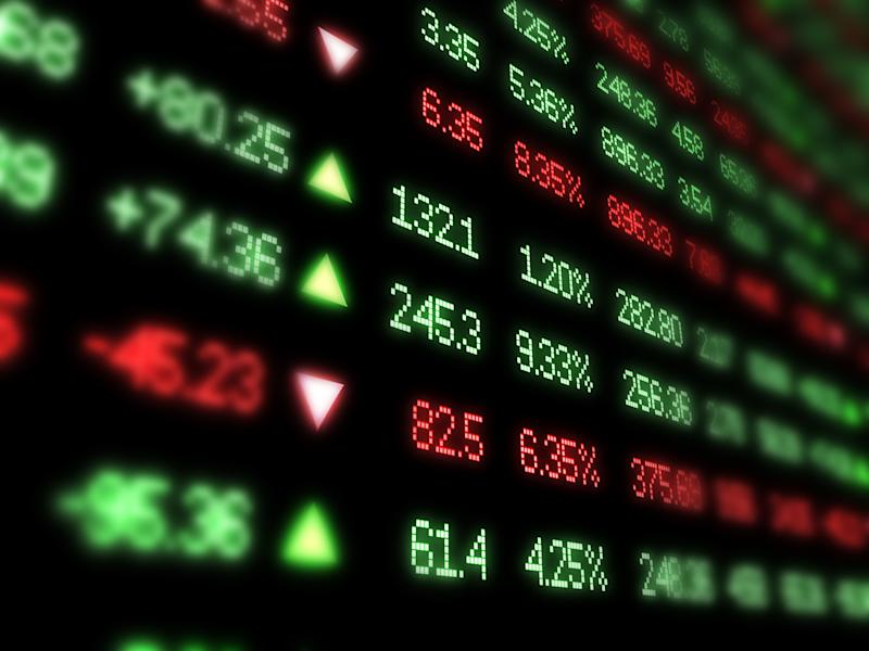 Red and green columns of numbers showing stock price movements on a black background