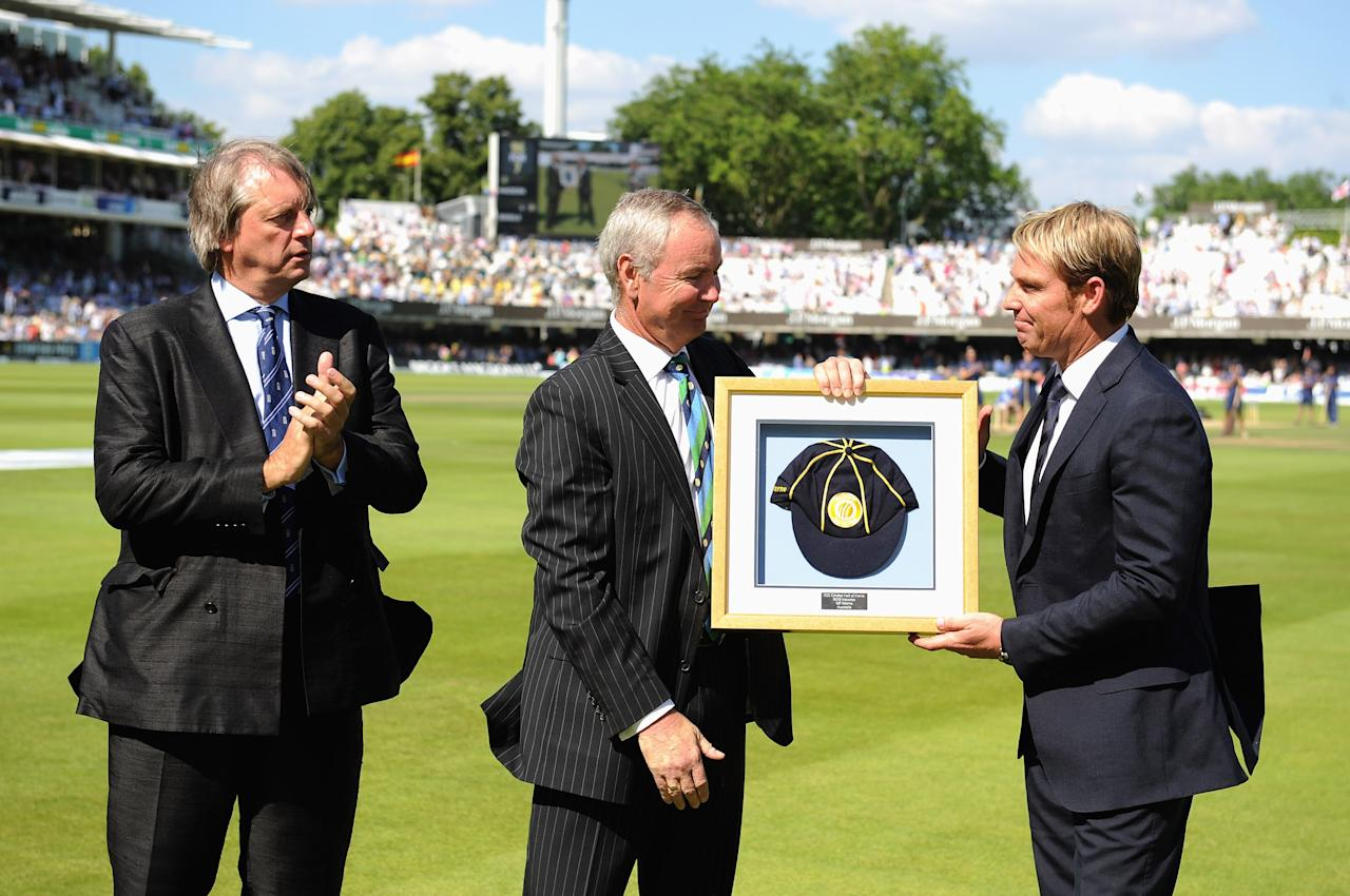 LONDON, ENGLAND - JULY 19: Shane Warne (R) of Australia is inducted into the ICC Hall of Fame by ICC President Alan Isaac (C) as ECB Chairman Giles Clarke looks on during day two of the 2nd Investec Ashes Test match between England and Australia at Lord's Cricket Ground on July 19, 2013 in London, England. (Photo by Gareth Copley/Getty Images)