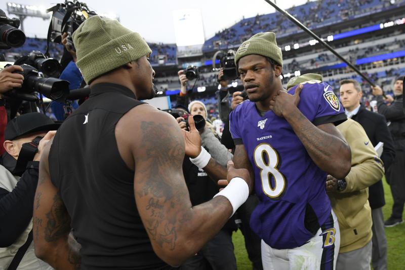 Houston Texans quarterback Deshaun Watson, left, shakes hands with Baltimore Ravens quarterback Lamar Jackson after an NFL football game, Sunday, Nov. 17, 2019, in Baltimore. The Ravens won 41-7. (AP Photo/Nick Wass)