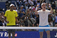 Joe Salisbury, of Great Britain, right, and teammate Rajeev Ram, of the United States, celebrate their men's doubles final victory over Bruno Soares, of Brazil, and Jamie Murray, of Great Britain, at the US Open tennis championships, Friday, Sept. 10, 2021, in New York. (AP Photo/Elise Amendola)