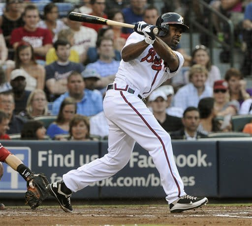 Atlanta Braves' Michael Bourn singles against the Arizona Diamondbacks during the second inning of a baseball game Tuesday, June 26, 2012, in Atlanta. (AP Photo/John Amis)