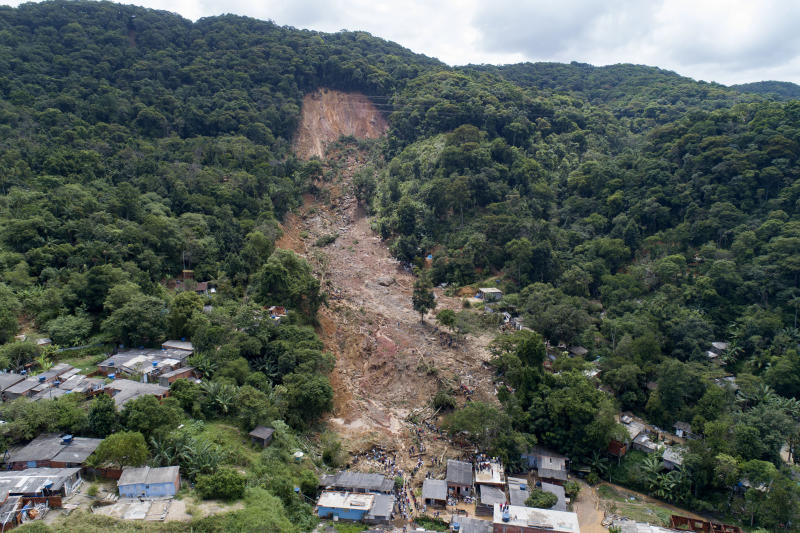 Trees are gone after a mudslide triggered by heavy rains in the coastal city of Guaruja, Brazil, Wednesday, March 4, 2020. (AP Photo/Andre Penner)