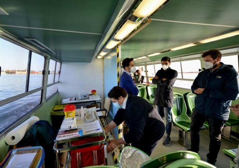 Medical workers in Venice used a vaporetto, a public water bus, as makeshift Covid-19 vaccination clinic for elderly residents on two islands