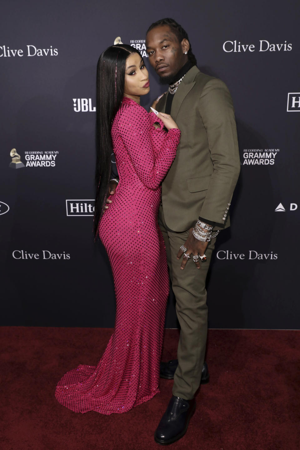 Cardi B, left, and Offset arrive at the Pre-Grammy Gala And Salute To Industry Icons at the Beverly Hilton Hotel on Saturday, Jan. 25, 2020, in Beverly Hills, Calif. (Photo by Mark Von Holden/Invision/AP)