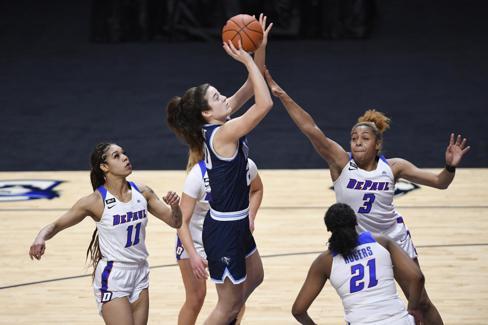 Villanova's Maddy Siegrist shoots over DePaul's Deja Church (3) during overtime of an NCAA college basketball game in the quarterfinals of the Big East Conference tournament at Mohegan Sun Arena, Saturday, March 6, 2021, in Uncasville, Conn. (AP Photo/Jessica Hill)