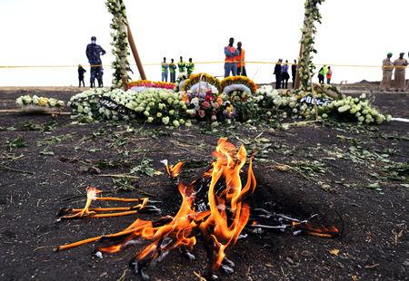 FILE PHOTO: Candle flames burn during a commemoration ceremony for the victims at the scene of the Ethiopian Airlines Flight ET 302 plane crash, near the town Bishoftu, near Addis Ababa, Ethiopia March 14, 2019. REUTERS/Tiksa Negeri/File Photo