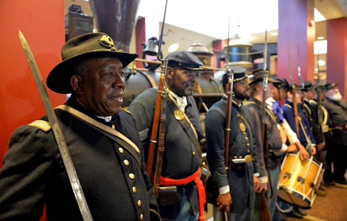 In this June 20, 2014, file photo, Civil War re-enactors Lt. James Hayes, from left, Samuel Stephenson and Marvin-Alonzo Greer participate in a Juneteenth celebration at the Atlanta Cyclorama and Civil War Museum in Atlanta. Juneteenth celebration started with the freed slaves of Galveston, Texas. Although the Emancipation Proclamation freed the slaves in the South in 1863, it could not be enforced in many places until after the end of the Civil War in 1865.