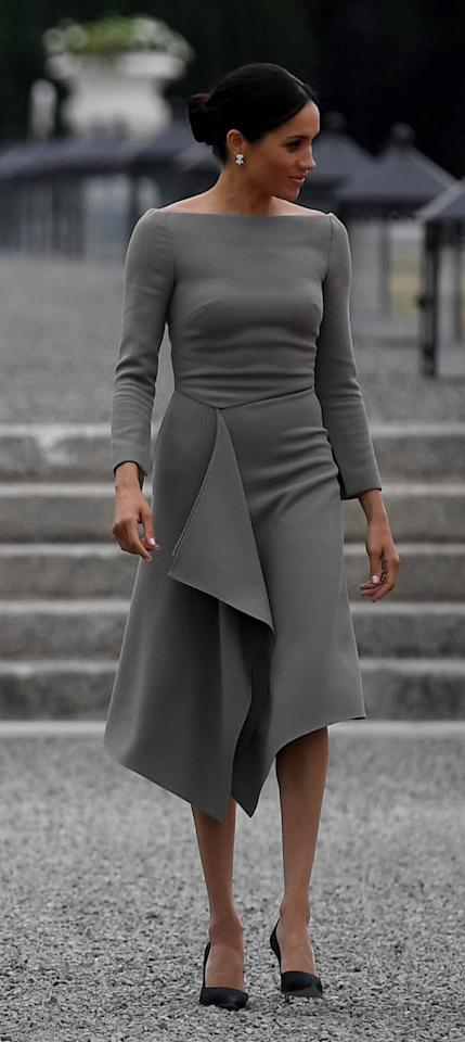 "<p>On day two of their trip, Markle chose a custom made grey dress by pal Roland Mouret to meet with Ireland's President, Michael Higgins, and his wife, Sabina Coyne. The Duchess paired her ""Clover"" dress (approximately $3,500 CAD) with black Paul Andrew pumps (approximately $1,000 CAD) and a Peekaboo bag by Fendi ($6,500). </p>"