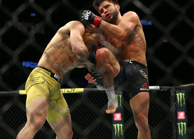 Henry Cejudo knees Marlon Moraes in their bantamweight championship bout during UFC 238 at United Center on June 8, 2019 in Chicago. (Rey Del Rio/Getty Images)